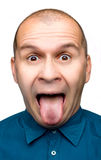 Adult man sticking tongue out. Isolated on white background Royalty Free Stock Images
