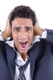 Adult man in suit holding his head and screaming Royalty Free Stock Photography