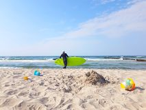 Adult man with sup board royalty free stock photography