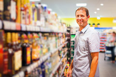 Adult Man At The Supermarket. Adult man buying groceries at the supermarket Stock Photography