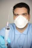 Adult man with syringe and bottle Stock Photo