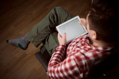 Adult man on tablet pc Stock Images