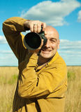 Adult man taking picture Royalty Free Stock Image
