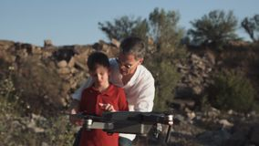 Man and son using drone stock footage