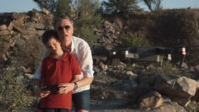 Man and son using drone stock video footage