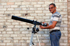 Adult man and telescope with camera Royalty Free Stock Photos
