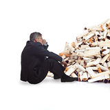 Adult man thinking in front of a bunch of cigarette butts Stock Photos