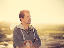 Adult man thinking at the sunset outdoors royalty free stock image