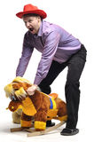 Adult man tomfoolery with a children toy. In studio Royalty Free Stock Images