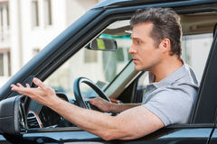 Adult man in a traffic jam royalty free stock photos