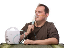 Adult man using inhalter Royalty Free Stock Photo