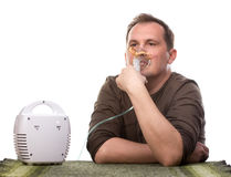Adult man using inhalter Royalty Free Stock Image