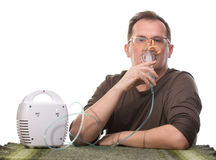 Adult man using inhalter Stock Photos