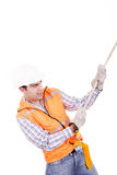 Adult man wearing safety equipment descending a rope Royalty Free Stock Images