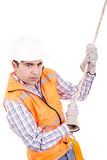 Adult man wearing safety equipment descending a rope Stock Image