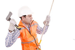 Adult man wearing safety equipment descending a rope Royalty Free Stock Image