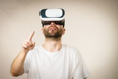 Adult man wearing vr goggles Royalty Free Stock Photography