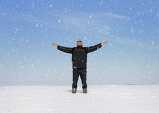 Adult man in winter landscape looking up Royalty Free Stock Photography