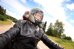 Adult man and woman bikers on the road Stock Image