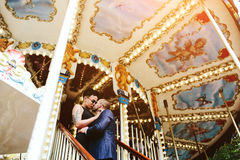Adult man and woman on a carousel. Adult men and women on merry go round carousel stock image