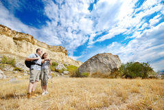 Adult man and woman are hiking Royalty Free Stock Image