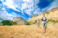 Adult man and woman are hiking stock image