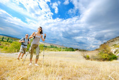 Adult man and woman are hiking stock photo