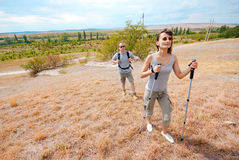 Adult man and woman are hiking Stock Photos