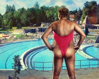 Adult man in woman's bathing suit Royalty Free Stock Photography