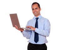 Adult man working with his laptop computer Stock Photos