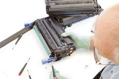 Adult man working toner cartridge Stock Photos