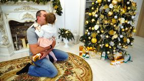 Laughing Baby Daughter And Dad Having Fun And Fooling Around, Laughing and Hugging in Large Room in Background Decorated. Adult Man and Young Father Playing With stock footage