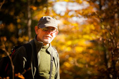 Adult mans portrait in autumn woods Royalty Free Stock Image