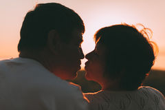 Adult married couple last to each other to kiss. Stock Photography
