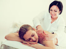 Adult masseuse working in salon Royalty Free Stock Photos