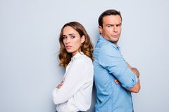 Adult mature sad, upset couple in shirts, casual outfit having f royalty free stock image