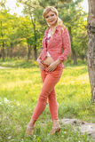 Adult mature woman happy in a park Stock Photo