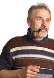 Adult men with a pipe in a hand Stock Photos
