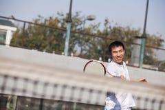 Adult men playing tennis Royalty Free Stock Image