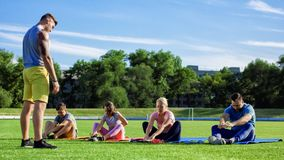 Family working out together on stadium stock photography