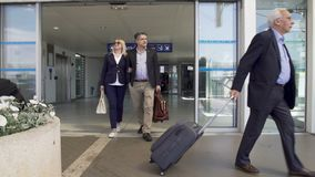 Adult and middle-aged couples leaving airport, people arrive on vacation banque de vidéos