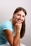 Adult Model. Adult Female Model wearing a striped blue top royalty free stock photography