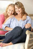 Adult mother and daughter at home Stock Photography