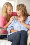 Adult mother and daughter at home Stock Images