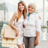 Adult mother and daughter. After shopping Stock Photos