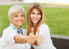 Adult mother and daughter showing OK Royalty Free Stock Image