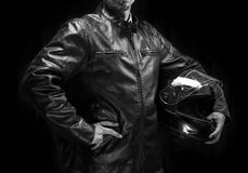 Adult motorcyclist in brown leather jacket. Stock Photo