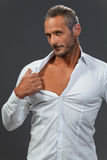 Adult muscular man showing his chest Royalty Free Stock Images