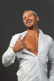 Adult muscular man showing his chest Royalty Free Stock Photos