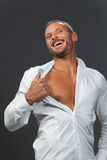 Adult muscular man showing his chest Stock Photos